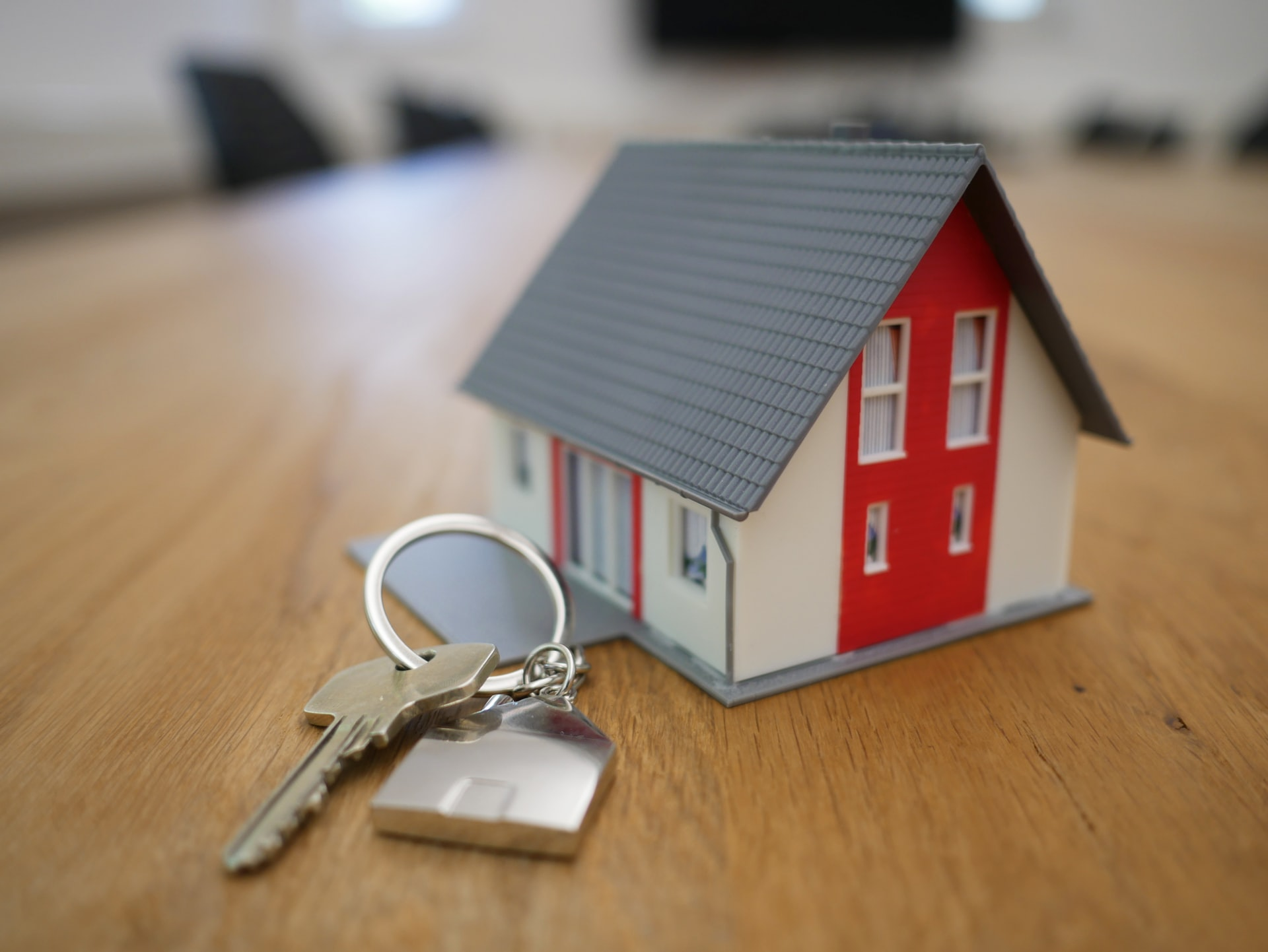 A toy house placed next to a house key