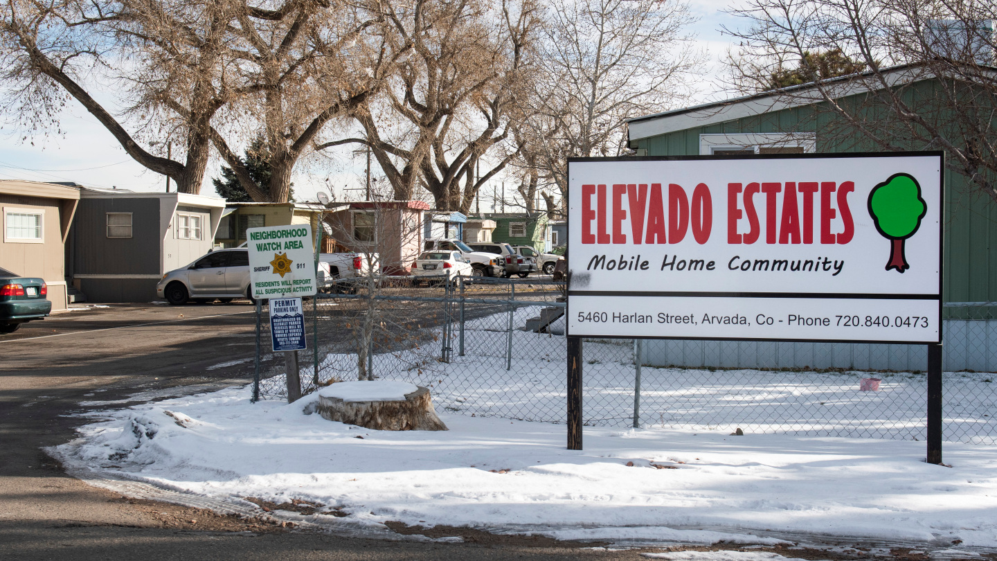 Image of the entrance to the Elevado Estates mobile home community in Arvada, CO with snow on the ground.