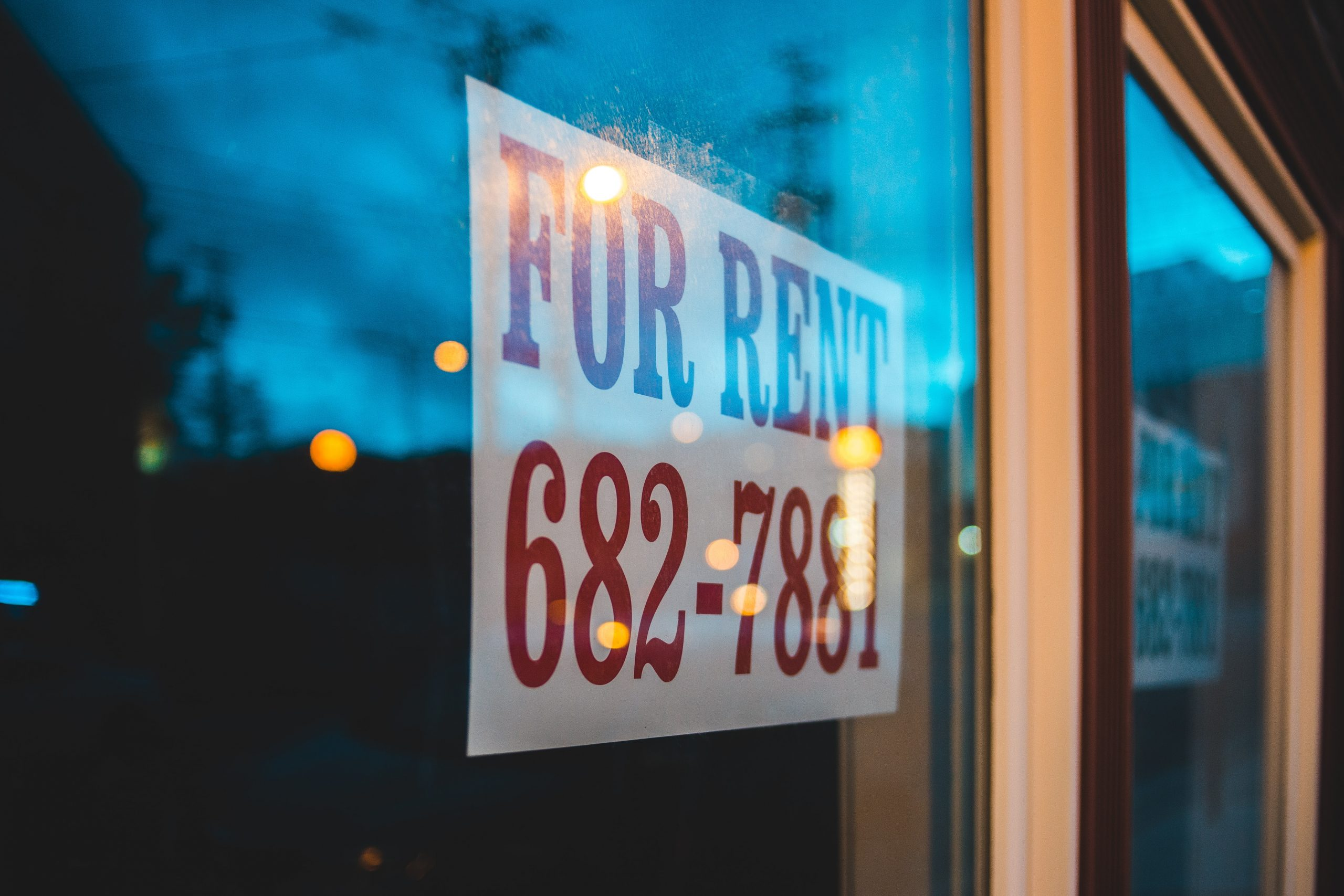"""Image of a """"For Rent"""" sign in a window."""